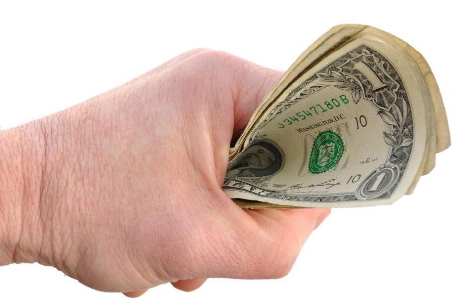 clutching money